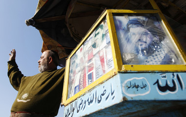 A picture of Lebanon's Hezbollah leader Nasrallah is pasted on a street vendor's carriage at Sidon