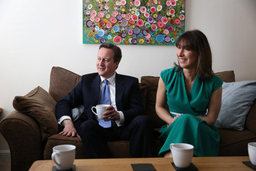 Britain's Prime Minister David Cameron and his wife Samantha visit the home of Nicole Calver and Paul Pearson during election campaiging in Swindon