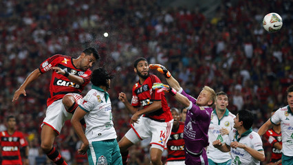 Santos of Brazil's Flamengo heads the ball to score against goalkeeper Yarbrough of Mexico's Leon during their Copa Libertadores soccer match in Rio de Janeiro