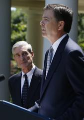 James Comey speaks alongside FBI director Mueller at the White House in Washington