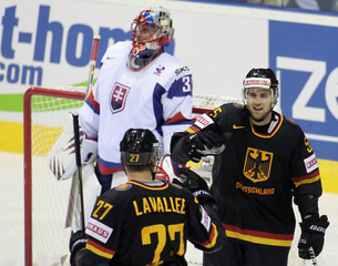 Germany's Schutz celebrates with teammate Lavallee after scoring past Slovakia's goaltender Halak during their Ice Hockey World Championship game in Bratislava
