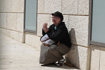 An ultra-Orthodox Jewish woman reacts upon hearing about the death of Rabbi Yosef at a hospital in Jerusalem