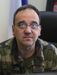 French Air Force General Philippe Adam, Commandant of the KAIA international airport, is seen in his office in Kabul