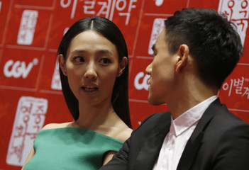 """Cast members Bai and Peng attend news conference to promote their movie """"A Wedding Invitation"""", the closing film of the Chinese Film Festival, in Seoul"""