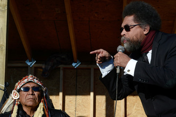 "Arvol Looking Horse, spiritual leader of the Sioux nation, listens to Cornell West speak in Oceti Sakowin camp as ""water protectors"" continue to demonstrate against plans to pass the Dakota Access pipeline near the Standing Rock Indian Reservation"