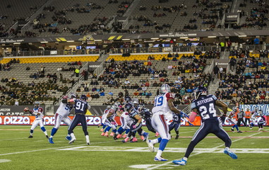Argonauts plays the Alouettes with empty seats in the background during their CFL football game in Hamilton