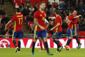 Spain's Iago Aspas celebrates scoring their first goal with Nolito