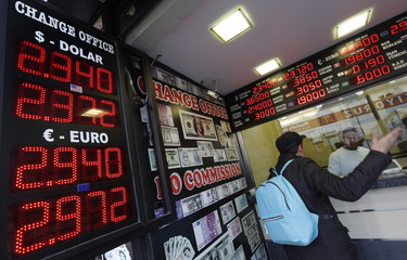 A man checks currency exchange rates at an currency exchange office in Istanbul