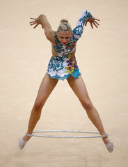 Austria's Caroline Weber competes using the hoop in her individual all-around gymnastics qualification match at the Wembley Arena during the London 2012 Olympic Games