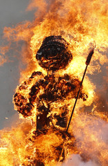 The Boeoegg, a snowman made of wadding and filled with firecrackers, burns atop a bonfire in the Sechselaeuten square in Zurich