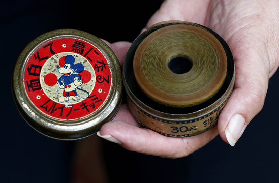 Dardenne shows a lithographed tin box, which is made in Japan and contains a 16mm movie of Mickey Mouse, displayed at her house in Grand-Hallet