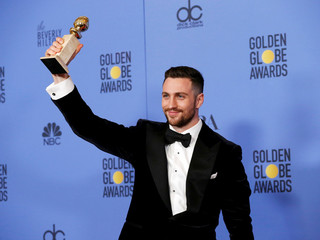 Aaron Taylor-Johnson holds his award during the 74th Annual Golden Globe Awards in Beverly Hills