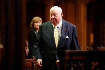 Senator Duffy walks in the Senate chamber on Parliament Hill in Ottawa