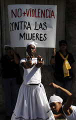 Women perform during a march in Independence Park to celebrate International Day for the Elimination of Violence Against Women in Santo Domingo