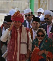 Pakistan's PM Ashraf gestures after offering prayers at the shrine of Sufi saint Khwaja Moinuddin Chishti at Ajmer