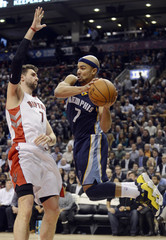Memphis Grizzlies Bayless passes around Toronto Raptors Bargnani during the second half of their NBA basketball game in Toronto