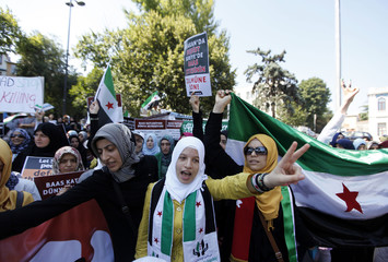 Syrians living in Turkey shout slogans during a protest against the government of Syrian President Bashar al-Assad, in Istanbul