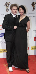 German actor Schweighoefer and Schramm arrive on the red carpet for 45th Golden Camera awards ceremony in Berlin