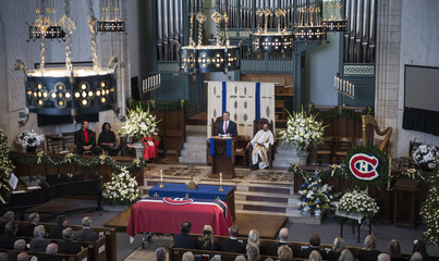 Former Montreal Canadiens' player Chris Nilan addresses the audience during funeral services for Canadiens' legend Dickie Moore at the Mountainside United Church, in Montreal