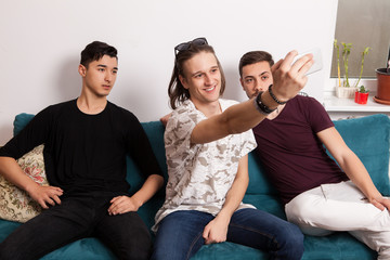 Friends hanging together and taking a selfie on the cellphone