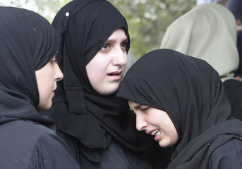 Relatives of Palestinian Hothayfa Solayman, 18, mourn during his funeral at Balaa village near the occupied West Bank city of Tulkarm
