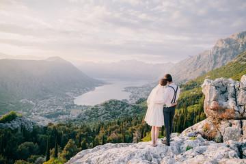 honeymoon wedding couple travel at sunset