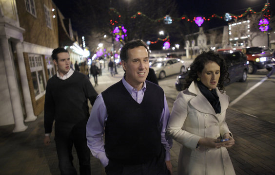 Republican presidential candidate Santorum leaves a campaign stop with his children in Orange City