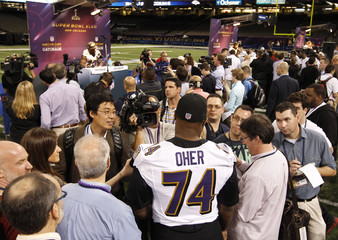 Baltimore Ravens tackle Michael Oher is interviewed by reporters during Media Day for the NFL's Super Bowl XLVII in New Orleans