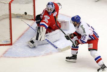 Czech Gulas tries to score past Russia's goaltender Sharychenkov during their Euro Hockey Tour ice hockey match in Karlovy Vary