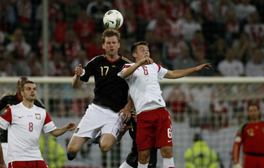 Germany's Mertesacker fight for the ball with Poland's Matuszczyk during their international friendly soccer match in Gdansk