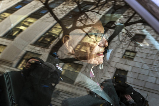 Rupert Murdoch, the chairman of News Corp and 21st Century Fox, departs New York State Supreme Court with his lawyers after a hearing in New York