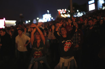 Spectators dance during a concert by Portuguese band Xutos & Pontapes at the Rock in Rio Music Festival in Lisbon