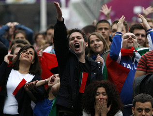 Italian supporters reacts during the Euro 2012 soccer match between Croatia and Italy at the fan zone in Poznan