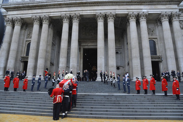 The Bearer Party, made up of eight personnel from all three armed services, carry the coffin of former British prime minister, Margaret Thatcher after the funeral service at St Paul's Cathedral in London