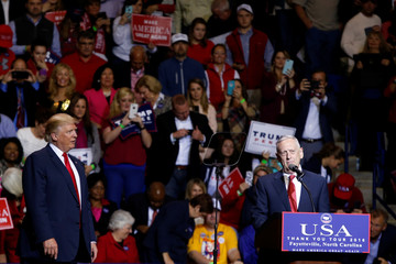 U.S. President-elect Donald Trump listens to General James Mattis speak at the USA Thank You Tour event at Crown Coliseum in Fayetteville, North Carolina