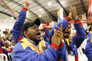 Venezuelan supporters cheer during Gonzalez's speech during anti-imperialist tribute, part of Youth Leftists Festival in Quito