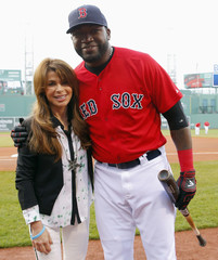 Entertainer Paula Abdul poses for a photograph with Red Sox's David Ortiz before the MLB Interleague baseball game between the Nationals and the Red Sox at Fenway Park in Boston