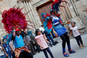 Members of an African dance group perform a traditional folk dance with Egyptian kids during the African-Chinese cultural festival, organised by Egypt's Ministry of Tourism, on the historic Moez Street, in Cairo