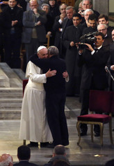 Pope Francis is embraced by Father Luigi Ciotti, president of the Libera association against mafia, as he arrives to lead an audience with the family members of mafia victims in Rome