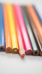 Color pencil on white background close up