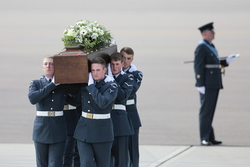 The coffin of David Thompson is carried from an RAF C-17, which repatriated the bodies of nine British nationals killed by a gunman in an attack at the Tunisian beach resort of Sousse, in RAF Brize Norton