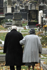 A couple walks at a cemetery in Vienna