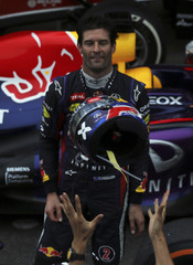Mark Webber of Australia throws his helmet to the crowd after the Brazilian F1 Grand Prix at the Interlagos circuit in Sao Paulo