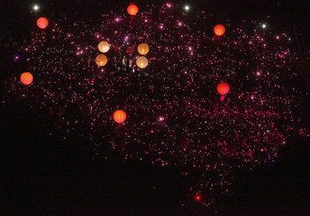People with LED lights take part in forming a giant pink dot in Singapore