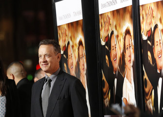 """Hanks poses at the premiere of """"Saving Mr. Banks"""" during the opening night of AFI Fest in Hollywood"""