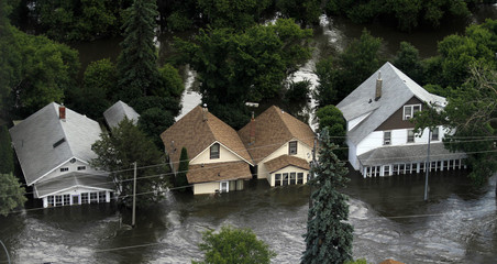 Houses in Minot, North Dakota are lost to floods, as the Souris River spills over levees and dikes