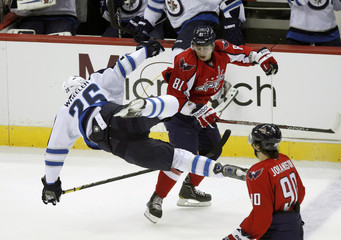 Winnipeg Jets Blake Wheeler (26) trips in front of Washington Capitals Dmitry Orlov (21) in second period during their NHL hockey game in Washington