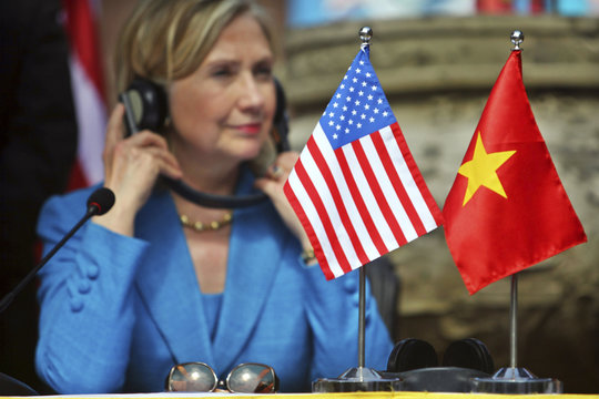 US Secretary of State Clinton listens to live translation during a signing ceremony of a memorandum of understanding for US support of HIV/AIDS programs in Vietnam in Hanoi