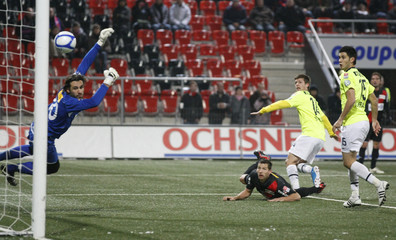 FC Basel's Stocker scores a goal to  Neuchatel Xamax's goalkeeper Ferro during their Swiss Super League soccer match  in Neuchatel