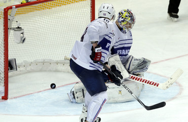 France's goaltender Quemener fails to save a goal of Canada's Burns during their Ice Hockey World Championship game in Prague